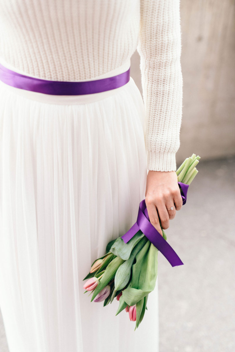 holding a tulip in one hand purple