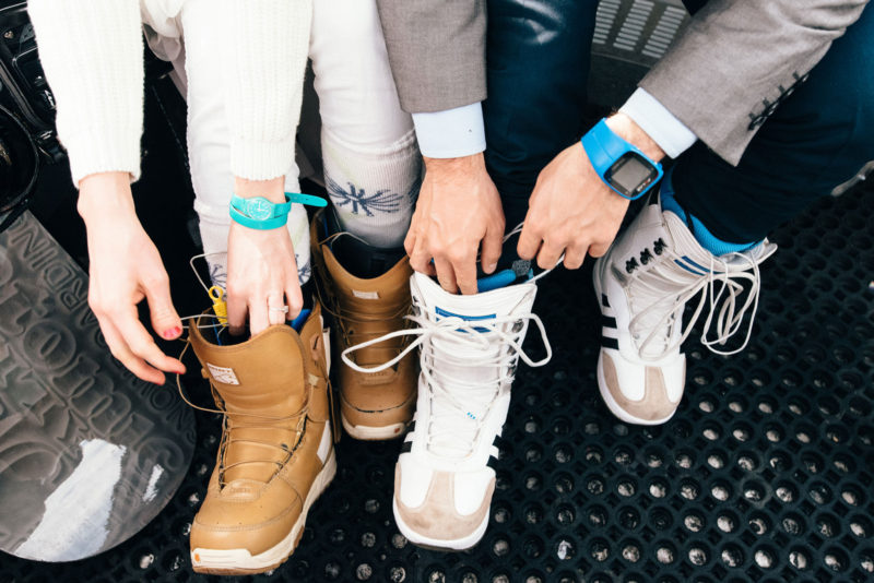 fastening snowboarding boots wedding