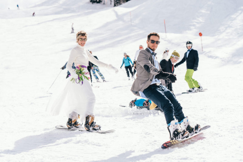 down the slopes bride dressed in white