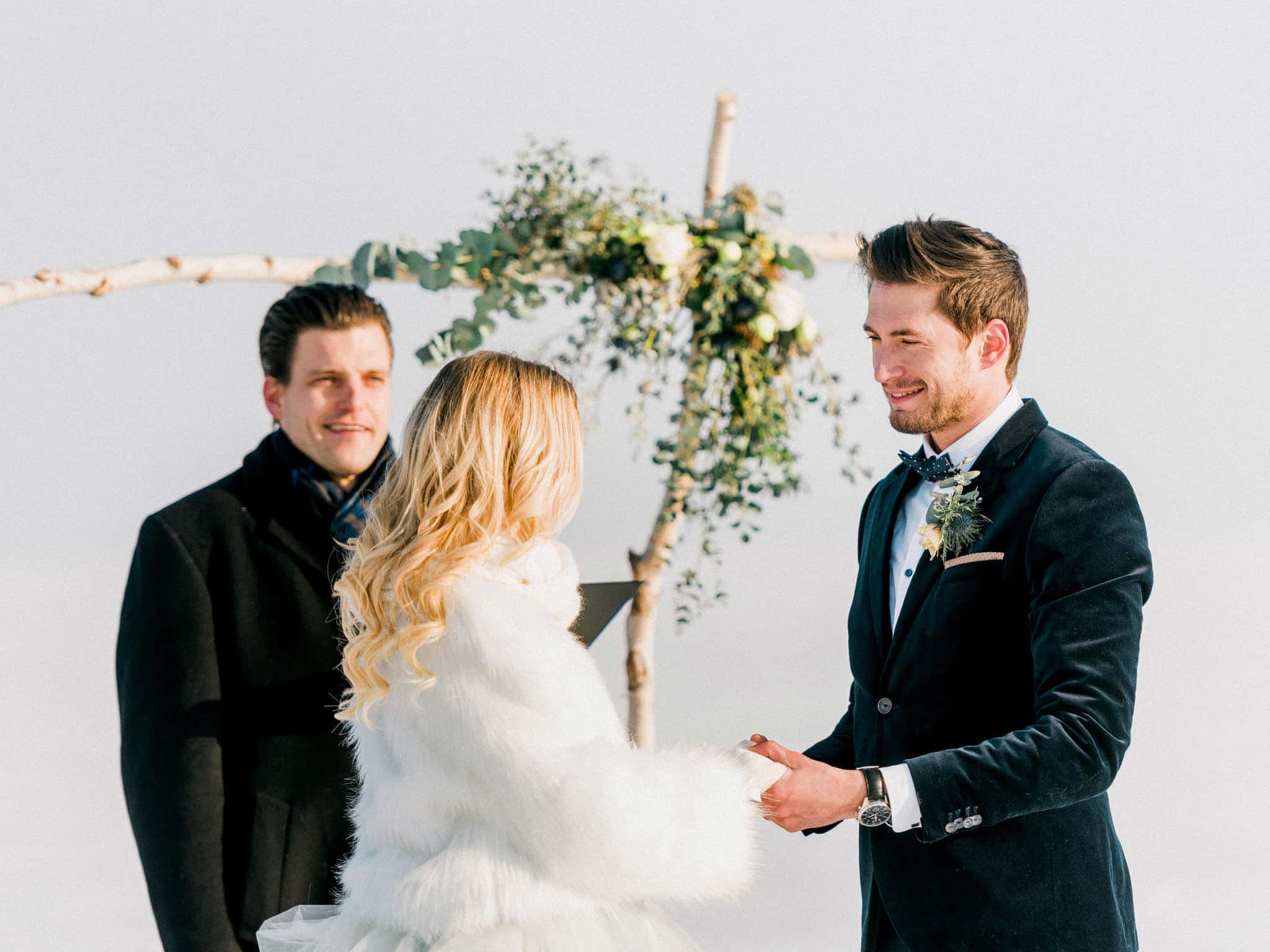 20_wedoverhills_elopement_holding_hand_wearing_bolero