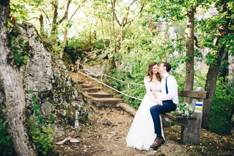couple-sitting-on-bench-wedding-portrait