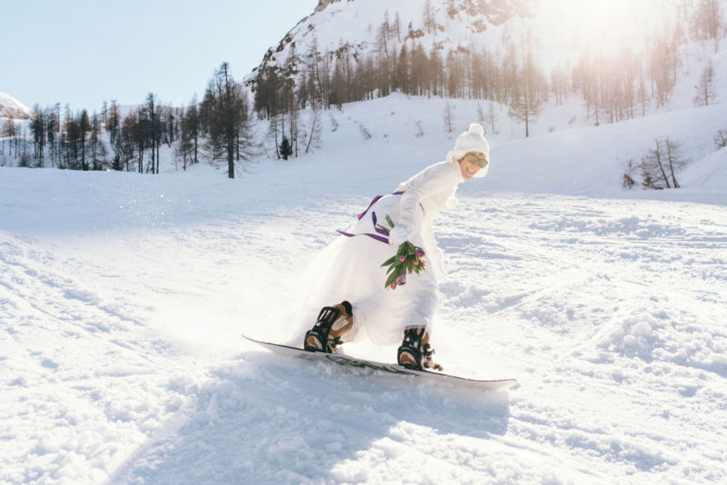 bride airing with a snowboard
